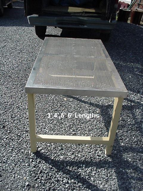 Perforated stainless tables Image